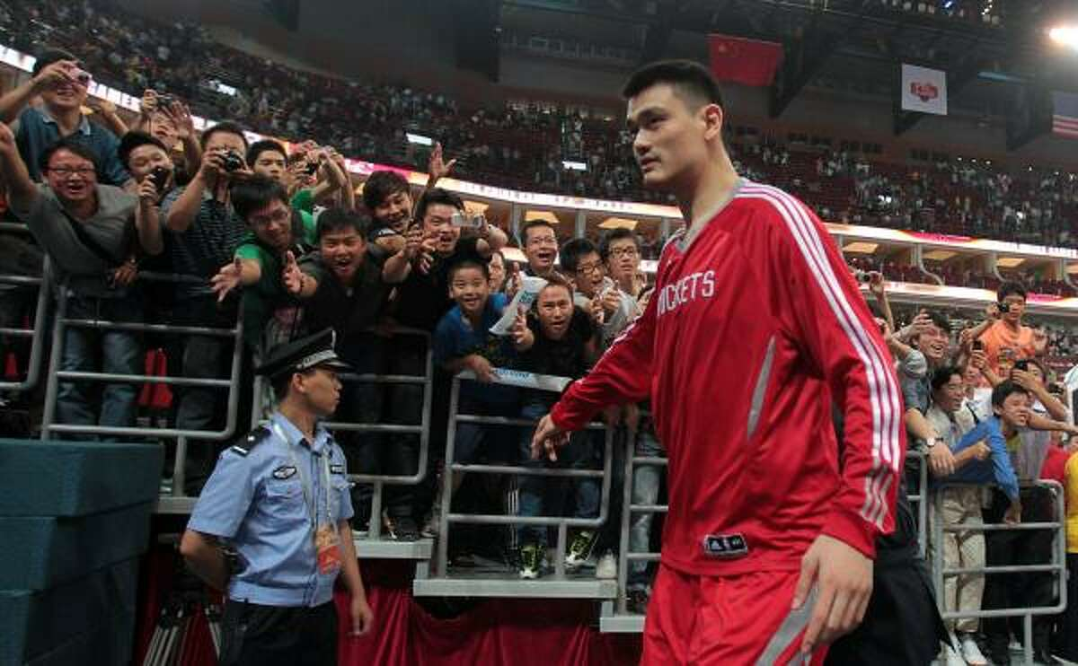 Rockets center Yao Ming, shown after a preseason game in Guangzhou, China, expects to return to the court.