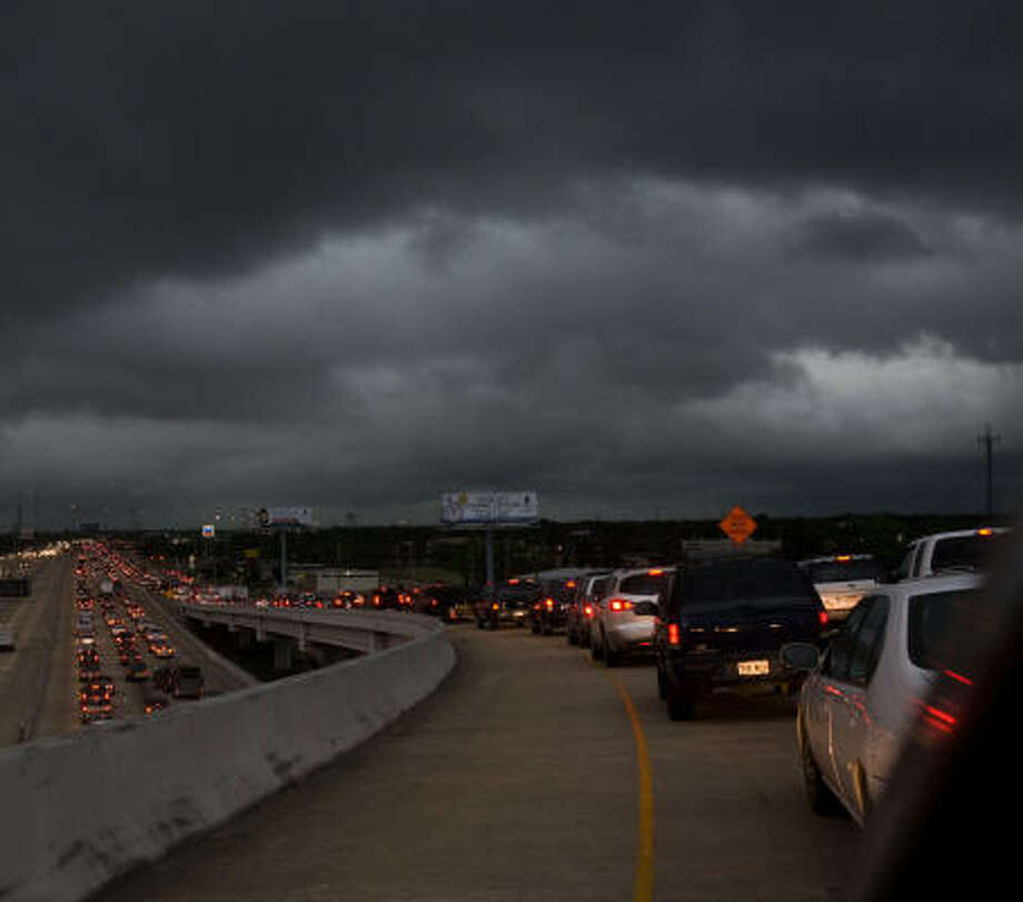 Traffic backs up on the Beltway 8 ramp to U.S. 290 northbound as a storm moves into the Houston area. There's also trouble ahead for Texas roads, lawmakers say. Photo: Johnny Hanson, Chronicle