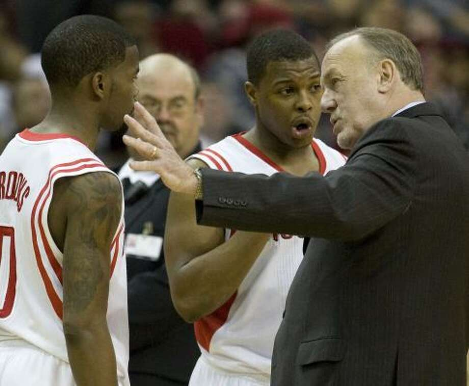 Rockets coach Rick Adelman, right, has yet to talk to guard Aaron Brooks, left, since Saturday's game against Memphis. Photo: George Bridges, MCT