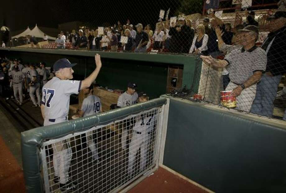 Rice coach Wayne Graham comes out for a curtain call and waves to the fans after leading the Owls to an 8-2 win over UH on Friday night. Photo: Thomas B. Shea, For The Chronicle