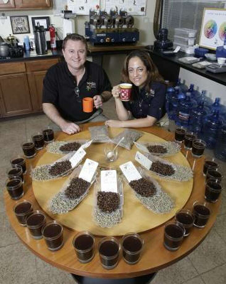 """At Carl and Monica Walker's Walker Coffee Trading, """"cupping"""" is an important part of determining coffee quality. Cupping is the art of tasting and smelling the product. Photo: Thomas B. Shea :, For The Chronicle"""