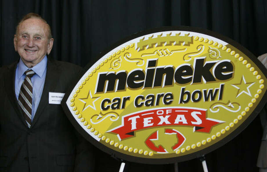 Sam Meineke, founder of Meineke Car Care Centers, showcases the logo for the Meineke Car Care Bowl of Texas. Photo: Karen Warren, Chronicle