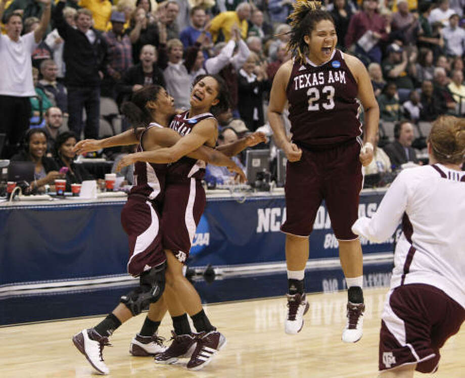 Texas A&M's Danielle Adams (23), Sydney Carter, center, and Sydney Colson, left, celebrate after beating Bayor on Tuesday night. Photo: LM Otero, AP