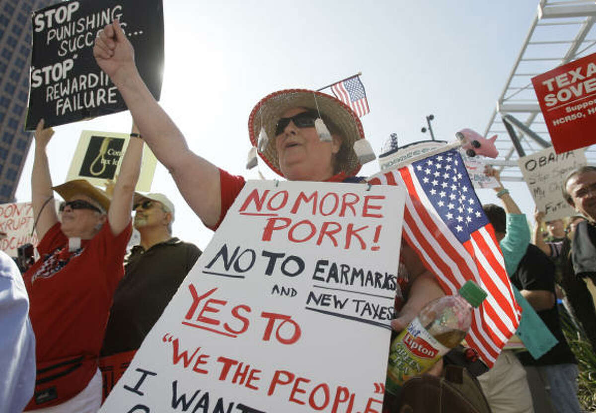 Members of the Houston Tea Party protest unprecedented government spending.
