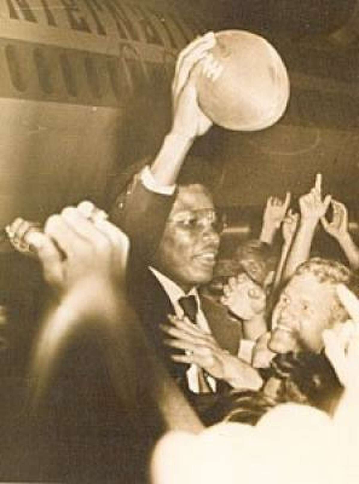 Hugh McElroy is greeted by fans at Easterwood Airport after helping Texas A&M defeat LSU 20-18 in 1970 with a late touchdown catch.