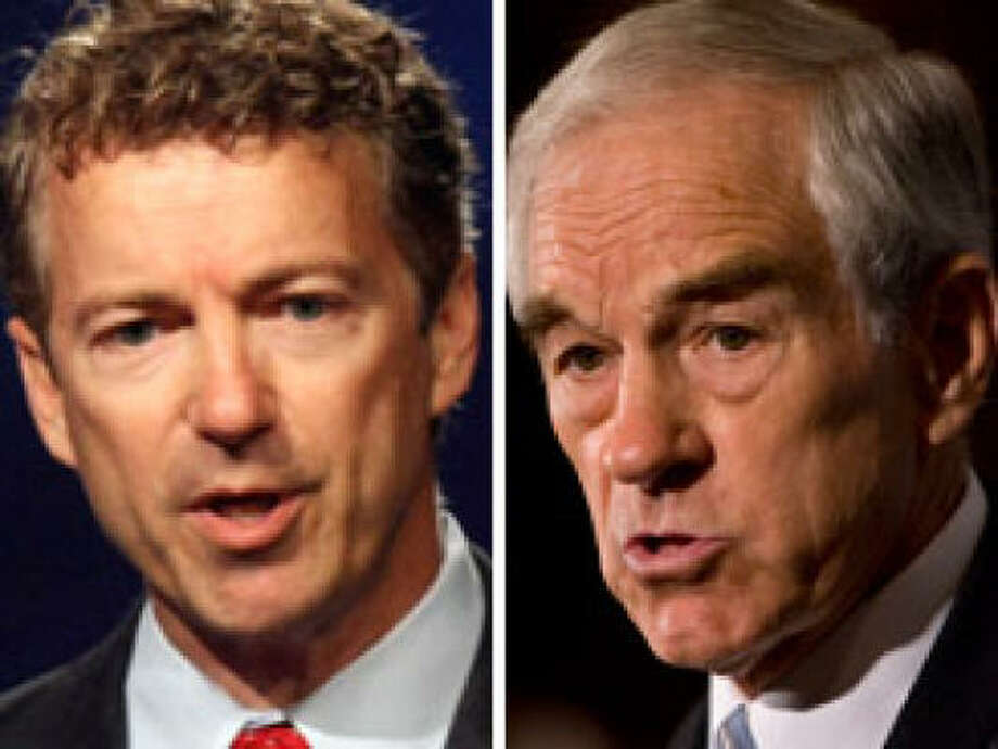 Analysts say Rand Paul, left, and his father, Ron, share similar beliefs on government and its role, but don't expect the son to be a copy of his dad while in office. Photo: Associated Press Photos