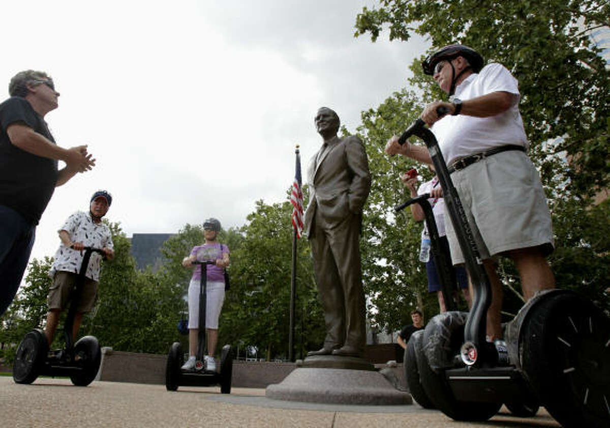 A statue of former Secretary of State James A. Baker III in Sesquicentennial Park is on the route of Segway Tours of Houston's bayou excursions. The tours cover about eight miles at a top speed of 8 mph.