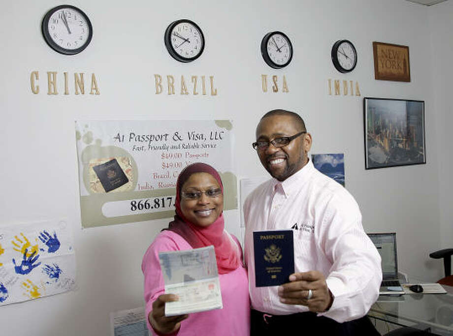 Omar and Amirah Saleem can turn around a passport or visa in 24 hours at their A1 Passport and Visa store in Houston. Photo: Thomas B. Shea, For The Chronicle