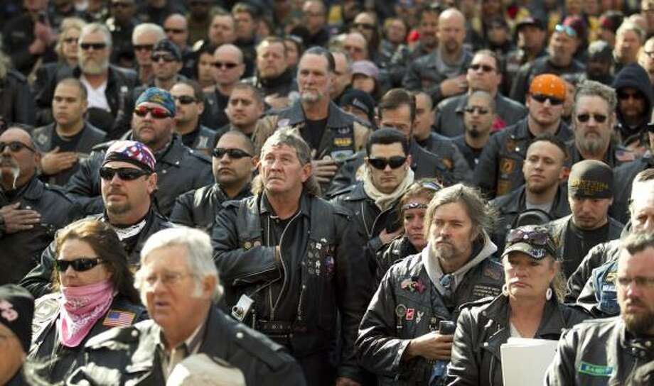 Bikers pause for the national anthem at the Texas Confederation of Clubs and Independents Legislative Day on Monday.  Hundreds of bikers from around the state rallied for bikers' rights and met their legislators. Photo: Jay Janner, Austin American-Statesman