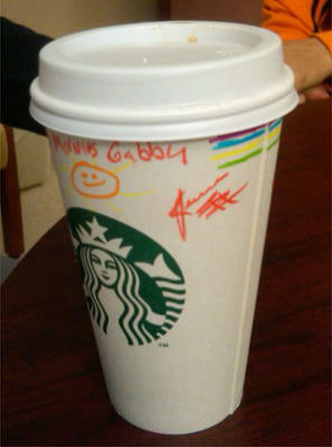 "From Rep. Gabrielle Giffords' Facebook page: ""Like most days, Mark jump-starts Gabby's morning by bringing her coffee & a newspaper before a busy day of speech therapy. (Decorated cup thanks to Starbucks staff.)"" Photo: Facebook.com"