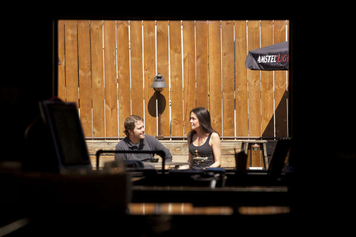 Little Woodrow's manager, Paul Smyers, takes a break with bartender Ashley Hawthorne on the pub's patio.