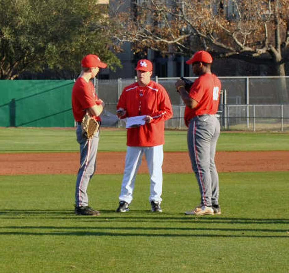 Todd Whitting, center, returned to UH as head coach after nearly a decade as an assistant at TCU. Photo: UH