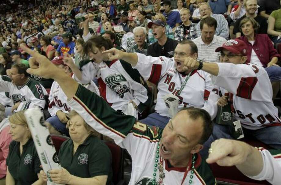 Jonathan Dziuk, front, joins other Aeros fans in helping make Toyota Center an inhospitable place for playoff visitors. Photo: Cody Duty, Chronicle