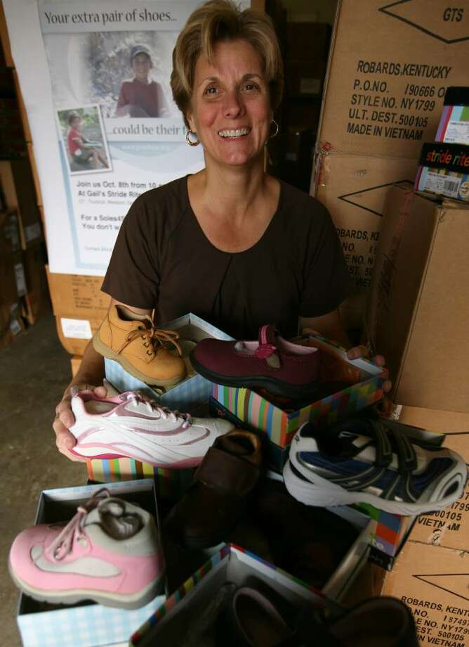 Gail Kennedy, owner of Gail's Stride Rite shoe stores, donates shoes to the Soles for Souls campaign, which collects and distributes shoes to people in needy areas of the world. Photo: Brian A. Pounds / Connecticut Post