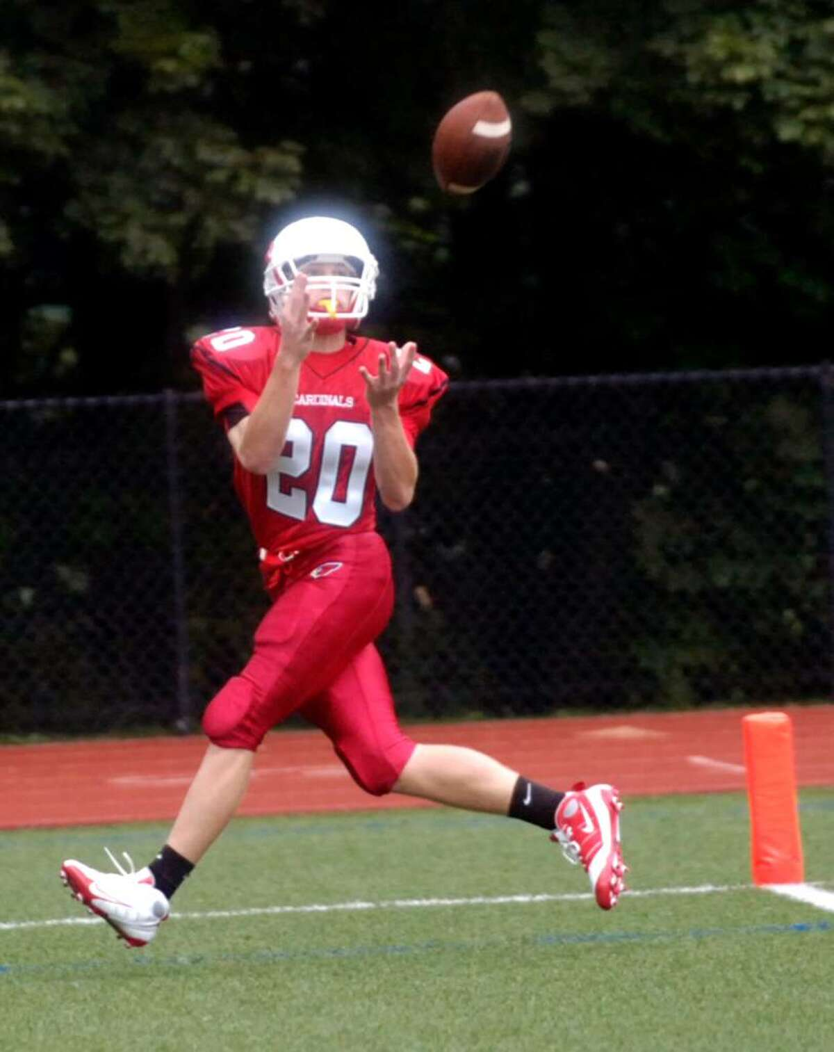 Greenwich High's Colin Dunster floats into the endzone to catch a touchdown pass as the Greenwich High football team hosts Harding High School for the Greenwich Homecoming game Saturday afternoon, Oct. 3, 2009.