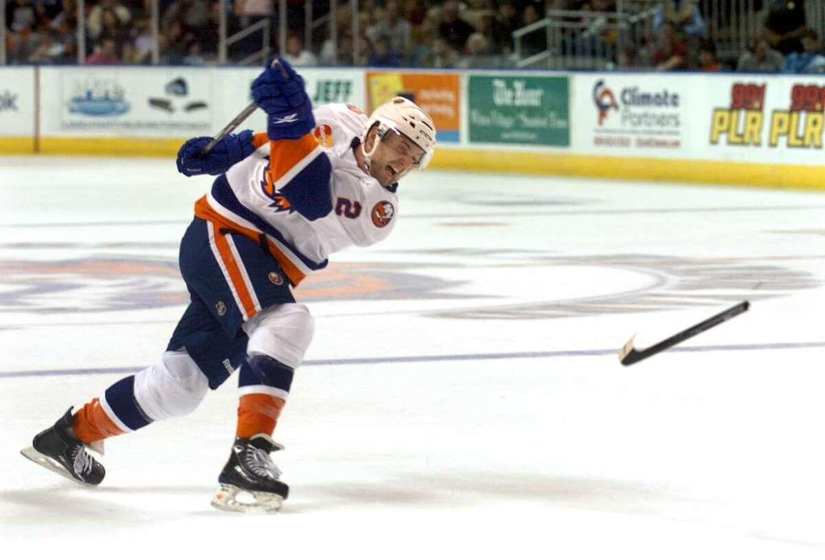 Sound Tigers #2 Andrew MacDonald breaks his stick after a slap shot, during season opening game action against the Lowell Devils in Bridgeport, Conn. on Saturday Oct. 03, 2009.
