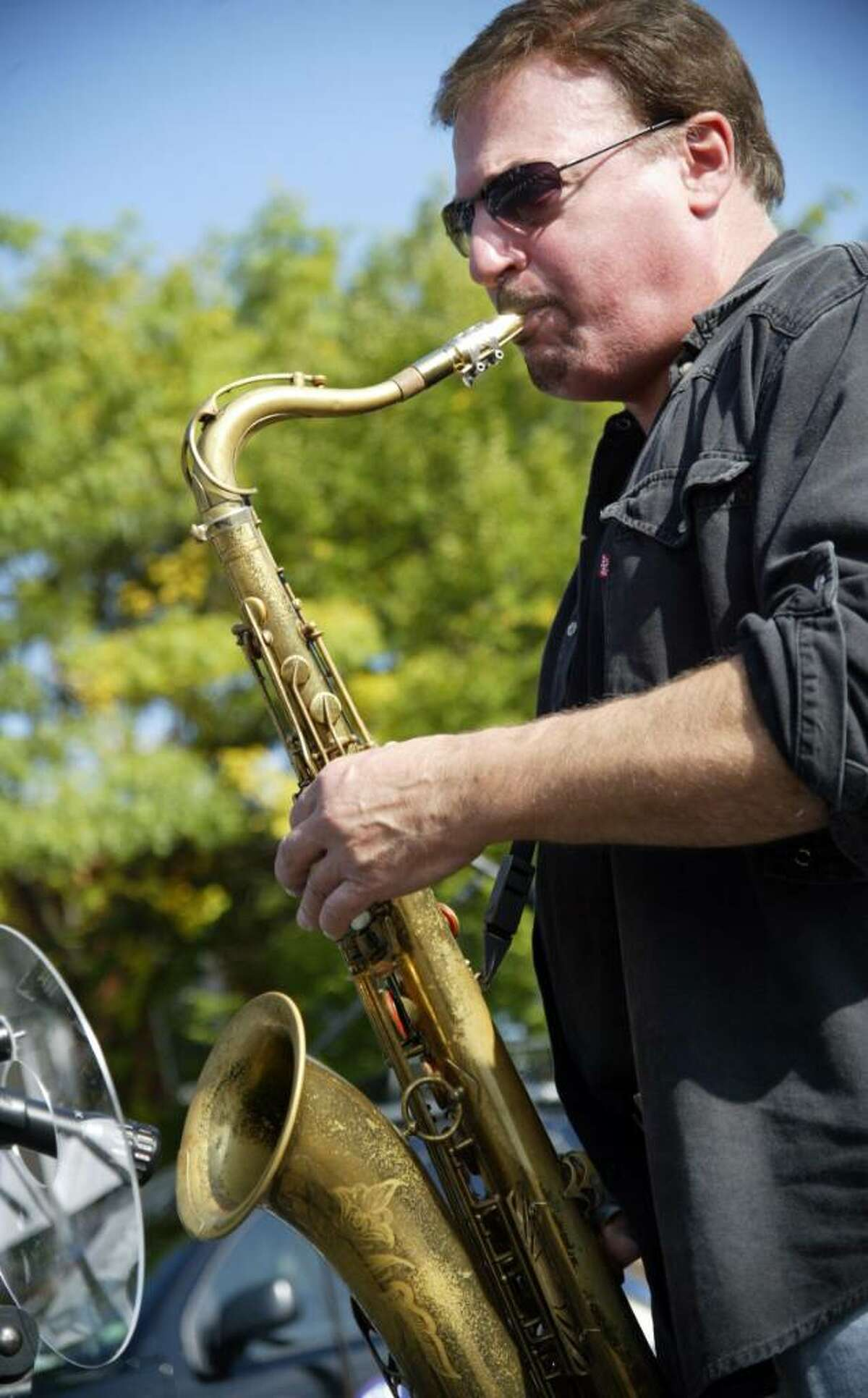 John Serio of Fairfield, belts out sax music, while playing with The Big Beat Band during the annual Shelton Festivities on Howe Avenue, Sunday, Oct. 4, 2009.