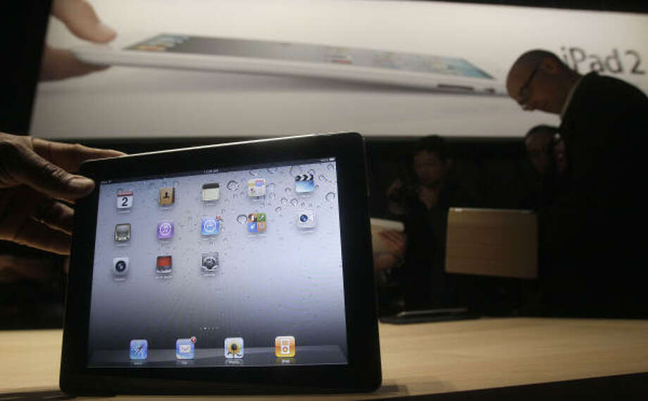 The iPad 2 is shown at an Apple event in San Francisco. Photo: Jeff  Chiu:, AP