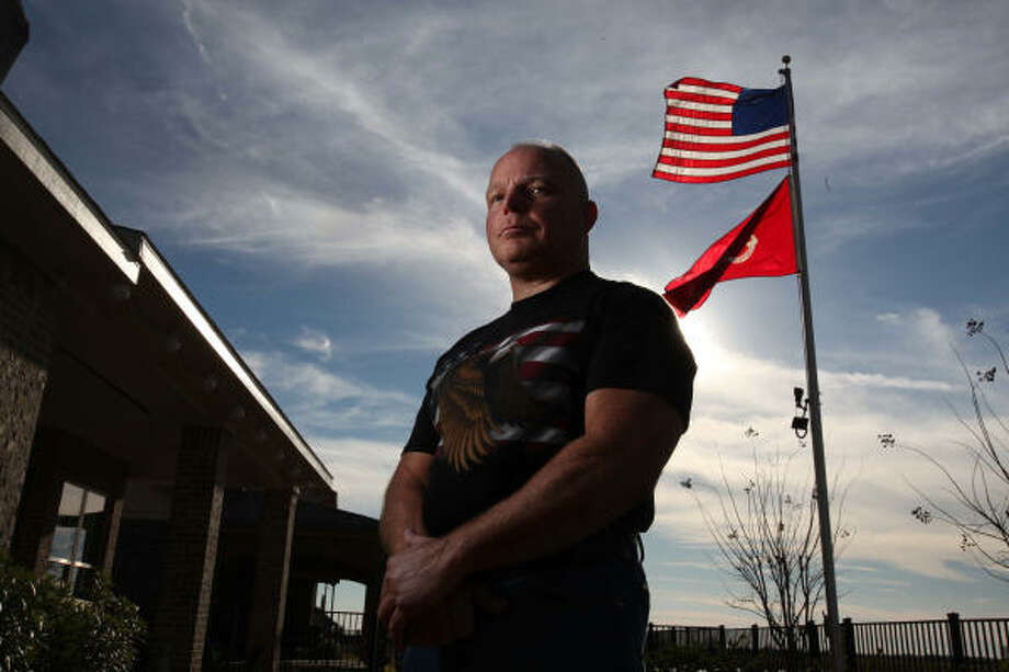"Marine veteran Michael Merola says he ""just didn't buy"" his neighborhood association's reasons why he couldn't put up his big flagpole. Photo: Mayra Beltran, Chronicle"