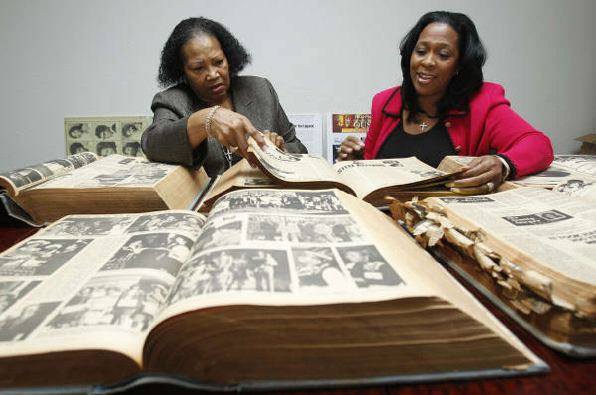 Henrietta Wilson, left, general manager of The Forward Times, and her niece, Karen Richards, publisher, look through archived editions of the paper to pull pages to display for their upcoming celebration of 50 years of publication.