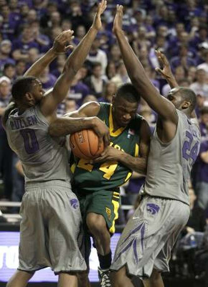Baylor guard LaceDarius Dunn is trapped by Kansas State guard Jacob Pullen (0) and forward Curtis Kelly (24) during the loss on Monday night. Photo: Charlie Riedel, AP