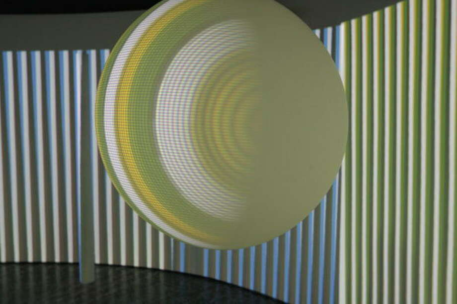 Carlos Cruz-Diez' walk-in light-projection installation 'Chromo-interference Environment' at the Museum of Fine Arts, Houston. Photo: Tonya Torres