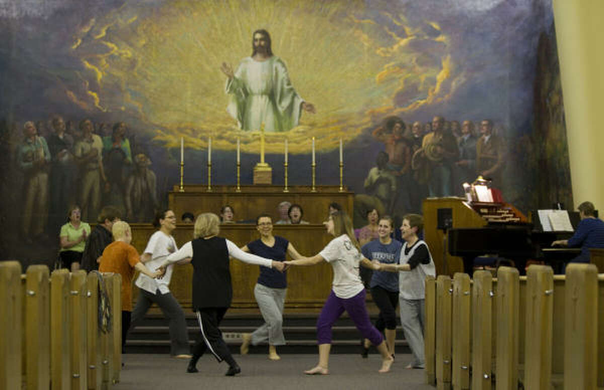 Ministry of Dance members practice their worship presentation in the sanctuary of the Church of the Redeemer. In the background is the historic East End Episcopal church's famed mural, called Christ of the Workingman.