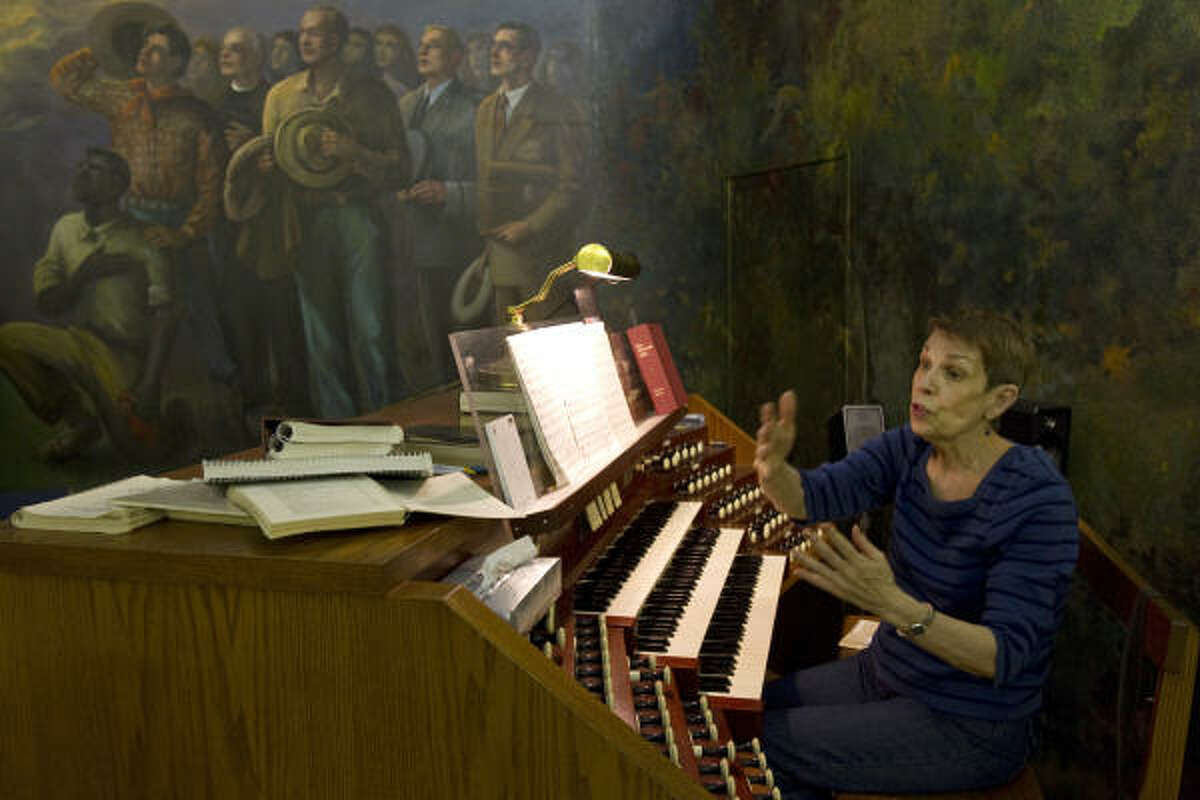 Pat Farra, the minister of music at Church of the Redeemer, gives directions during choir practice.