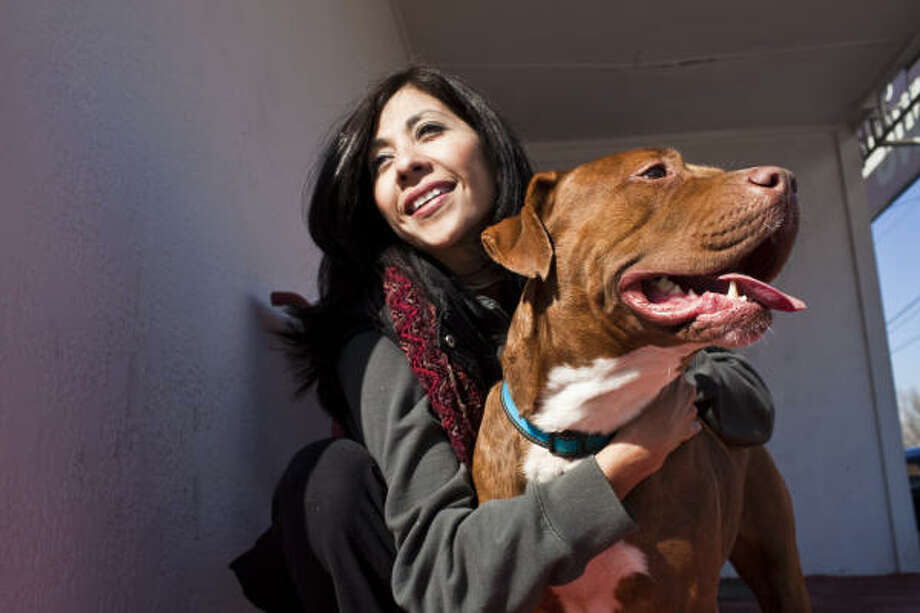 Gloria Medina Zenteno, with Apache, is the founder of Barrio Dogs of Houston, which promotes spay/neuter and pet care education. Photo: Eric Kayne