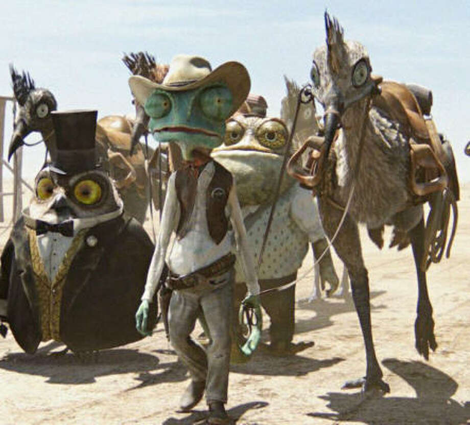 Rango (Johnny Depp) is an ordinary chameleon who accidentally winds up in the town of Dirt, a lawless outpost in the Wild West in desperate need of a new sheriff. Photo: Industrial Light & Magic |, Paramount Pictures