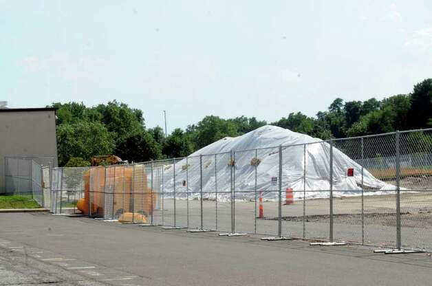 Plastic tarps cover contaminated soil at Greenwich High School on Monday, Aug. 1, 2011.  The district closed all playing fields on the property last week after test discovered PCBs near two fields. School officials said Monday they expect more information within the week to determine if and when any of the school's athletic fields can be reopened. Photo: Helen Neafsey / Greenwich Time
