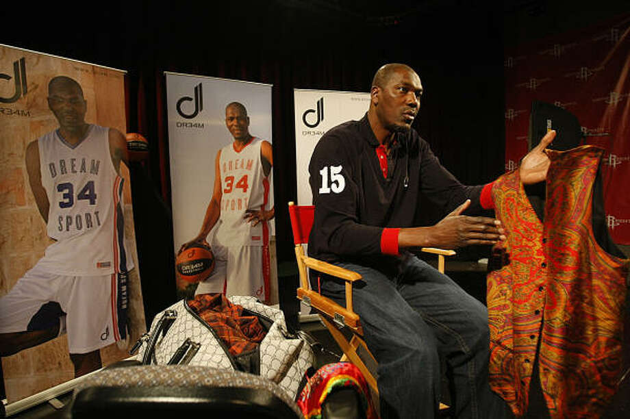 "Hakeem Olajuwon says he's always been into fashion. ""I don't like to wear things that everyone else wears."" Photo: Johnny Hanson, Houston Chronicle"