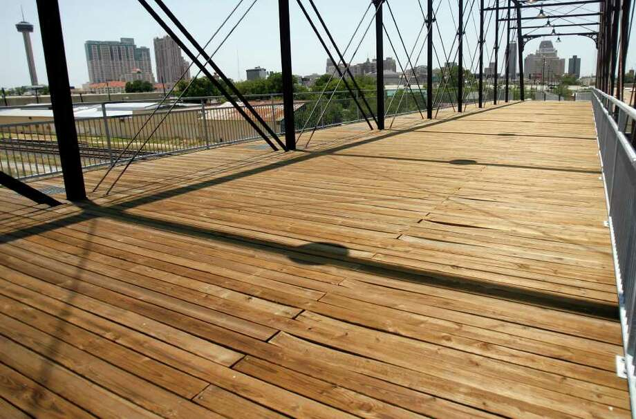 Hays Street Bridge will be closing down on July 11 to repair sections of the wooden deck after the planks have been warped due to humidity and heat.  Tuesday, July 5, 2011. OMAR PEREZ/operez@express-news.net Photo: OMAR PEREZ / SAN ANTONIO EXPRESS-NEWS