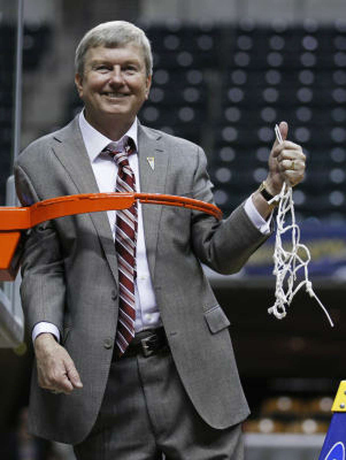 Texas A&M head coach Gary Blair stands inside the hoop after cutting the net after his team's 76-70 win over Notre Dame in the women's NCAA championship game in Indianapolis on Tuesday.
