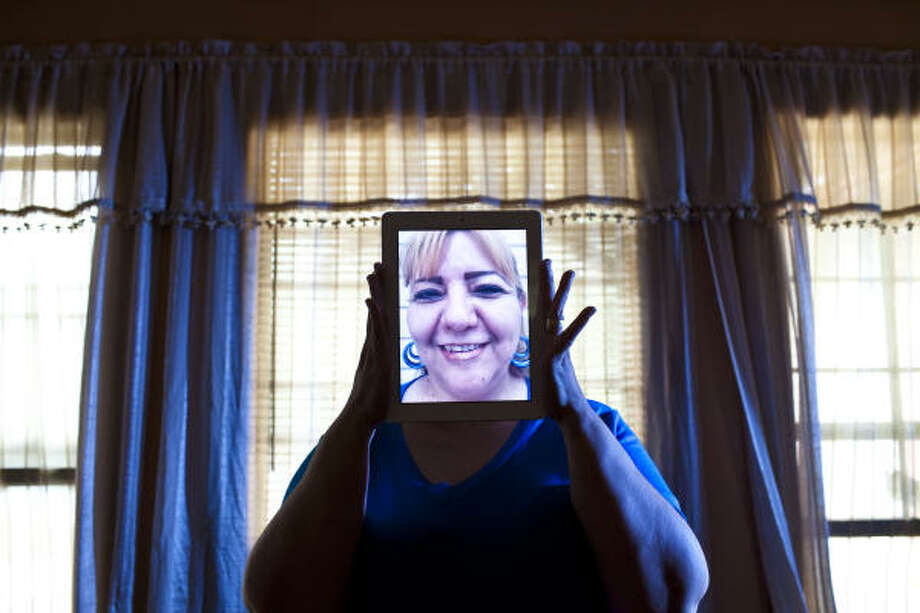 "Leticia Aguirre of east Houston may be the first person in America to connect to the Internet by ""super Wi-Fi,"" thanks to a partnership between Rice University and Technology For All. Photo: Eric Kayne, For The Chronicle"