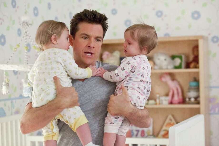 Dave (JASON BATEMAN) struggles with his twins in ?The Change-Up?, the new comedy from the director of Wedding Crashers and the writers of The Hangover that takes the body-switching movie where it?s never gone before. Photo: Photo Credit: Richard Cartwright / Copyright: © 2011 Universal Studios. ALL RIGHTS RESERVED.