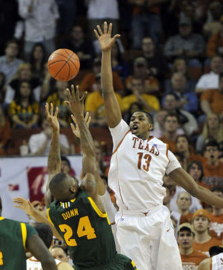 Texas forward Tristan Thompson attempts to block a shot by Baylor guard LaceDarius Dunn during the second half on Saturday. Photo: Michael Thomas, AP
