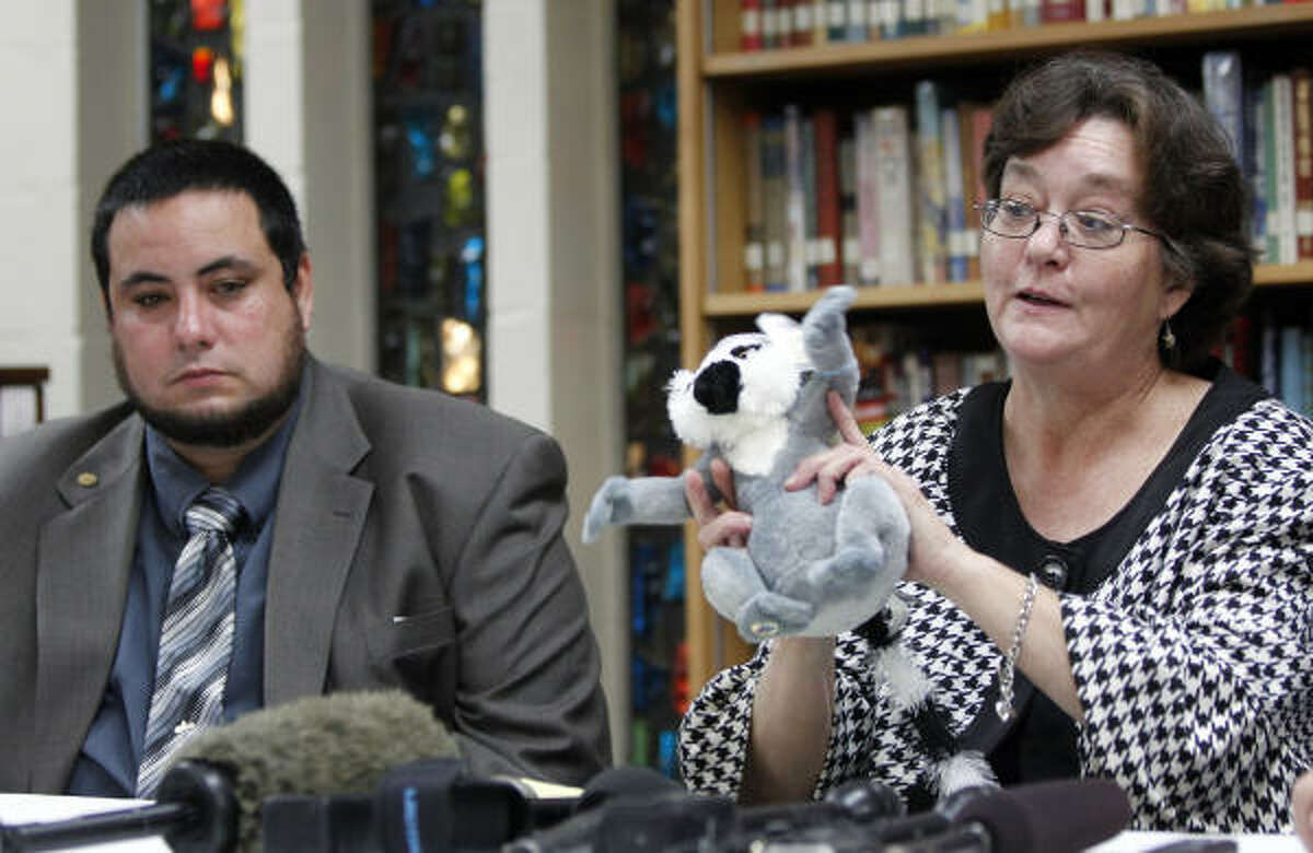 Glenn Scrimsher, left, with his mother, Mary Gifford, grandmother of Jonathan Foster, 12, talk to the media before Foster's funeral service at Garden Oaks Baptist Church, 3206 North Shepherd Drive, Tuesday, Jan. 4, 2011, in Houston. She explains the stuffed animal is a lemur and was not Jonathan's, but one she recently got and that the lemur character in the Madagascar movie reminds her of Jonathan.