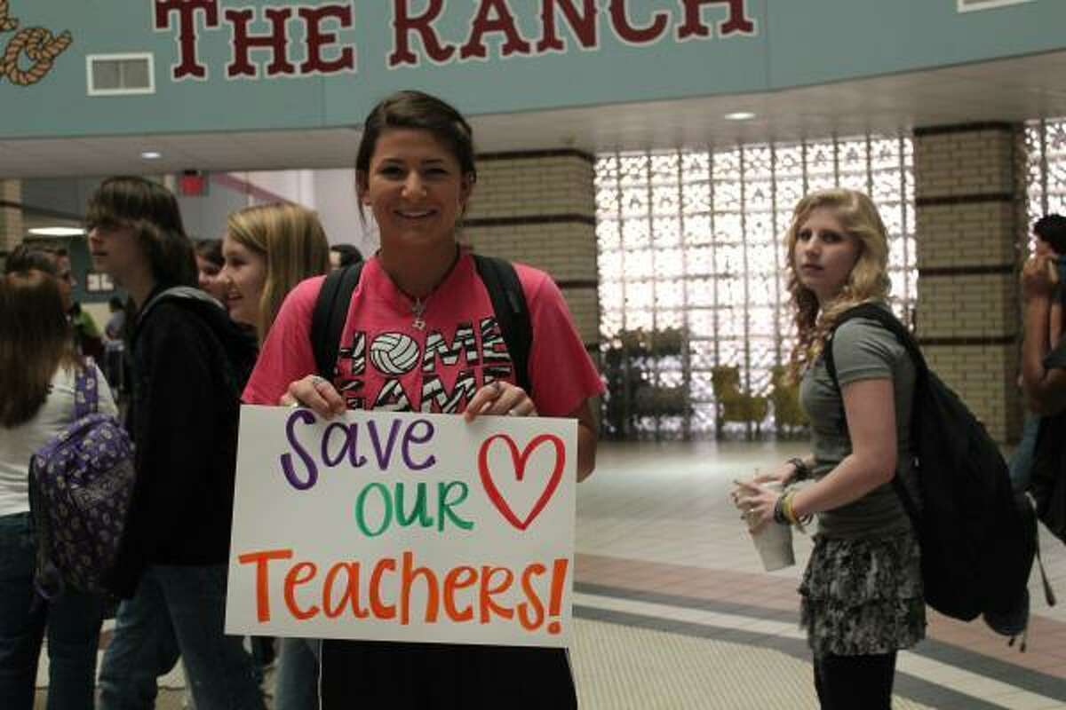 A student at Cinco Ranch High School protests on campus Thursday.
