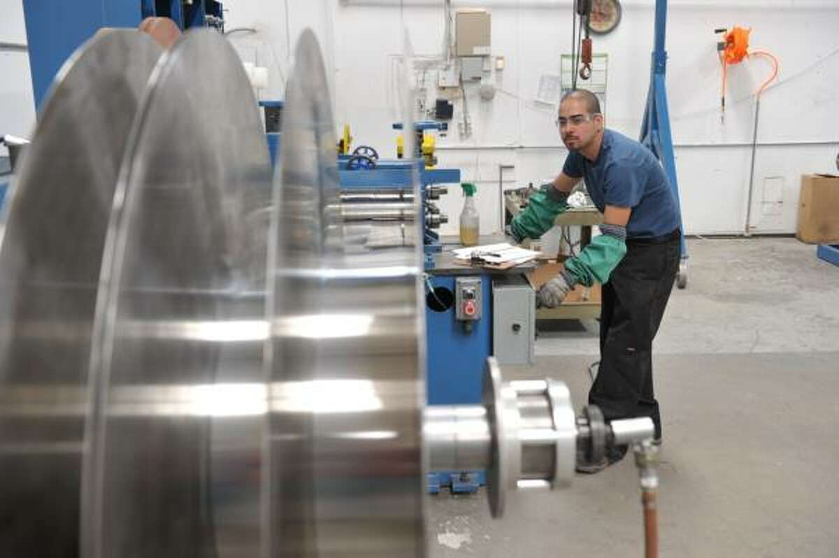 """An Eagle Brass worker in El Paso make coils for Juarez customers. """"As brisk and healthy as the economy in El Paso is, it would have been twice or three times as much if not for the violence"""" in Juarez, the company's Jerry Shapiro said."""