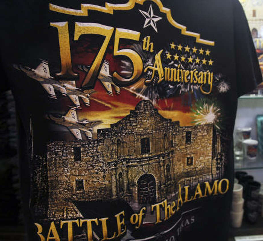 Although memorabilia is on sale commemorating the 175th anniversary of the Battle of the Alamo, a celebration to mark the event has been postponed. Photo: Tom Reel, San Antonio Express-News