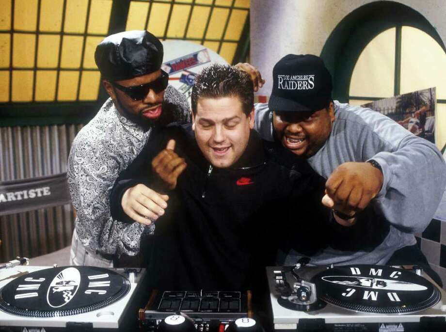Yo! MTV Raps premiered on MTV on Aug. 6, 1988, and was hosted by Doctor Dré, Ed Lover and Fab 5 Freddy. The show was a lively mix of rap videos, guest appearances by rap stars who did interviews and live performances. In this photo, Ted Demme, producer of Yo! MTV Raps with Hosts Ed Lover (left) and Doctor Dré at the MTV Studios in 1988.  Photo: Frank Micelotta, Getty Images / Getty Images North America