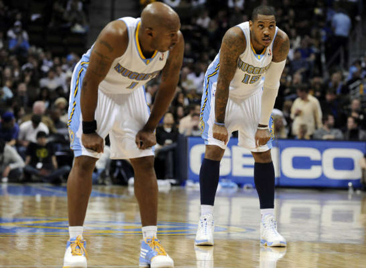 Denver Nuggets forward Carmelo Anthony, right, and teammate Chauncey Billups, left, could be on the move soon.