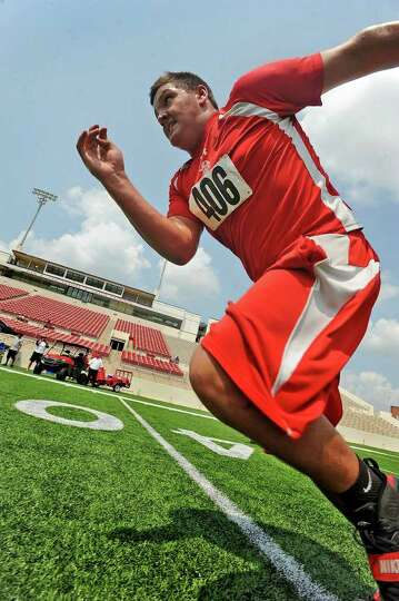 Deweyville's Daniel Brinson takes off into a sprint during Lamar's football camp on Thursday. Guisep