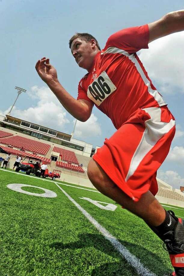 Deweyville's Daniel Brinson takes off into a sprint during Lamar's football camp on Thursday. Guiseppe Barranco/The Enterprise Photo: Guiseppe Barranco