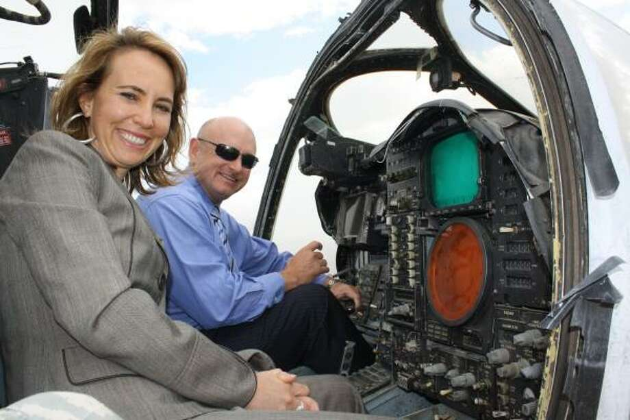 Gabrielle Giffords and Mark Kelly are shown in 2009 at Davis-Monthan Air Force Base in Tucson, Ariz. Photo: Sara Hummel Rajca, Office Of Rep. Giffords