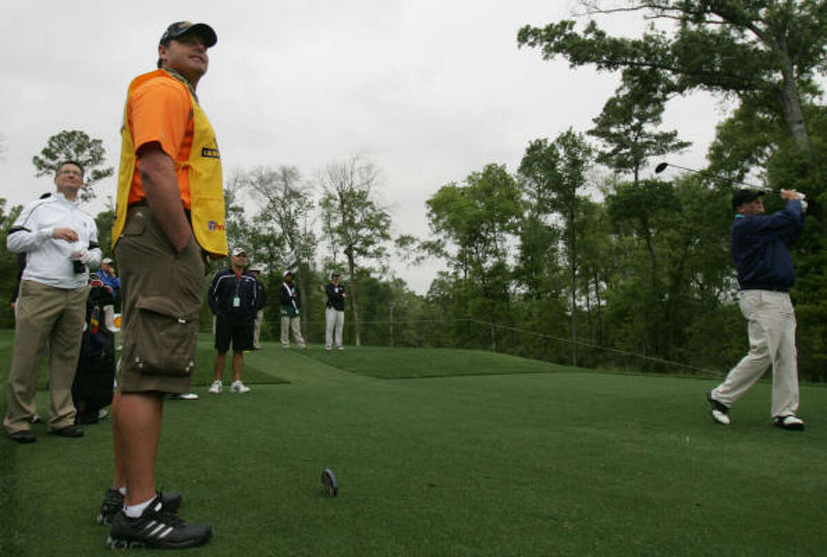 Former Astros pitcher Roger Clemens watches Craig Walker's tee shot at the Shell Houston Open Grand Pro-Am.