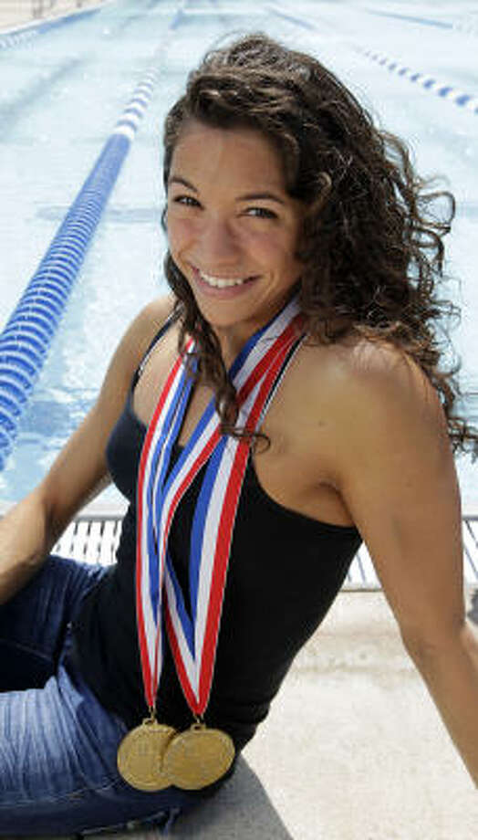 Dulles' Maddie Locus, with her two gold medals she won at state this year, is setting her sights on possible participation in the 2016 Olympics after competing for the University of Georgia. Photo: Karen Warren, Chronicle