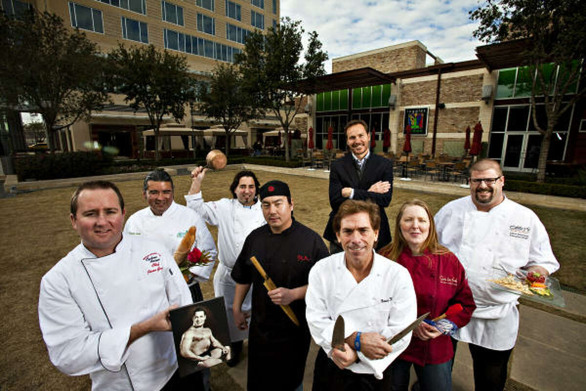 At CityCentre, from left, chefs David Luna of flora & muse; Jason Gould of Cyclone Anaya's; Juan Carlos Gonzalez of Bistro Alex; Jerry Jan of RA Sushi; CityCentre executive Jonathan Brinsden (back); Bruce Molzan of Ruggles Green; Jamie Williams of Sur La Table; and Jason Robinson of Eddie V's.