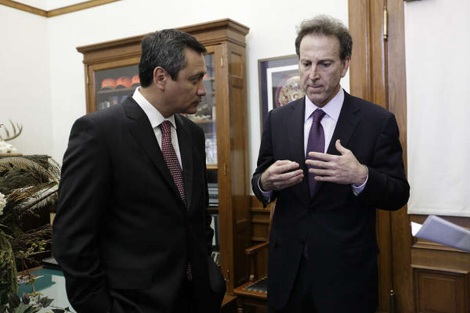 Hidalgo Gov. Miguel Angel Osorio Chong, left, and ex-U.S. envoy Tony Garza talk with the media Tuesday in Austin. Photo: Jerry Lara, San Antonio Express-News